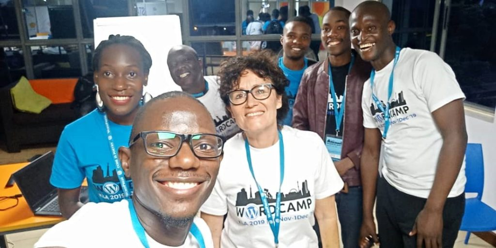 One of our directors, Micheal Musamba shares a selfie with some of the speakers at WordCamp Kampala 2019.